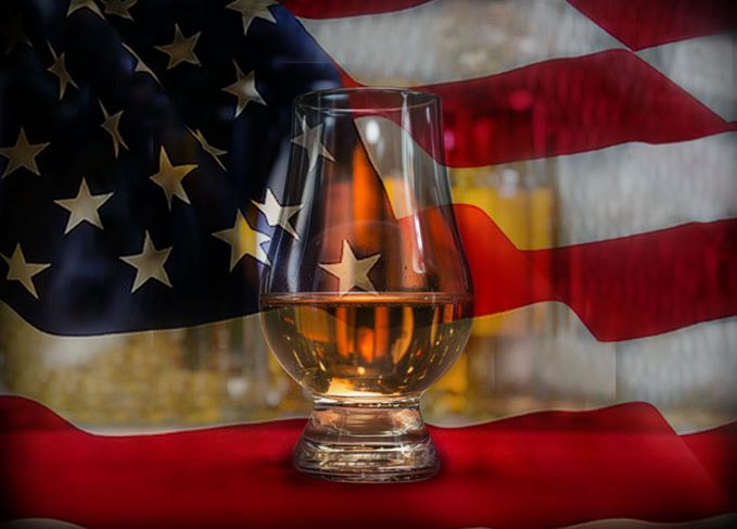 Scotch whisky glass and an American flag